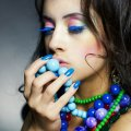 Fashion photo of young beautiful girl with bright beads