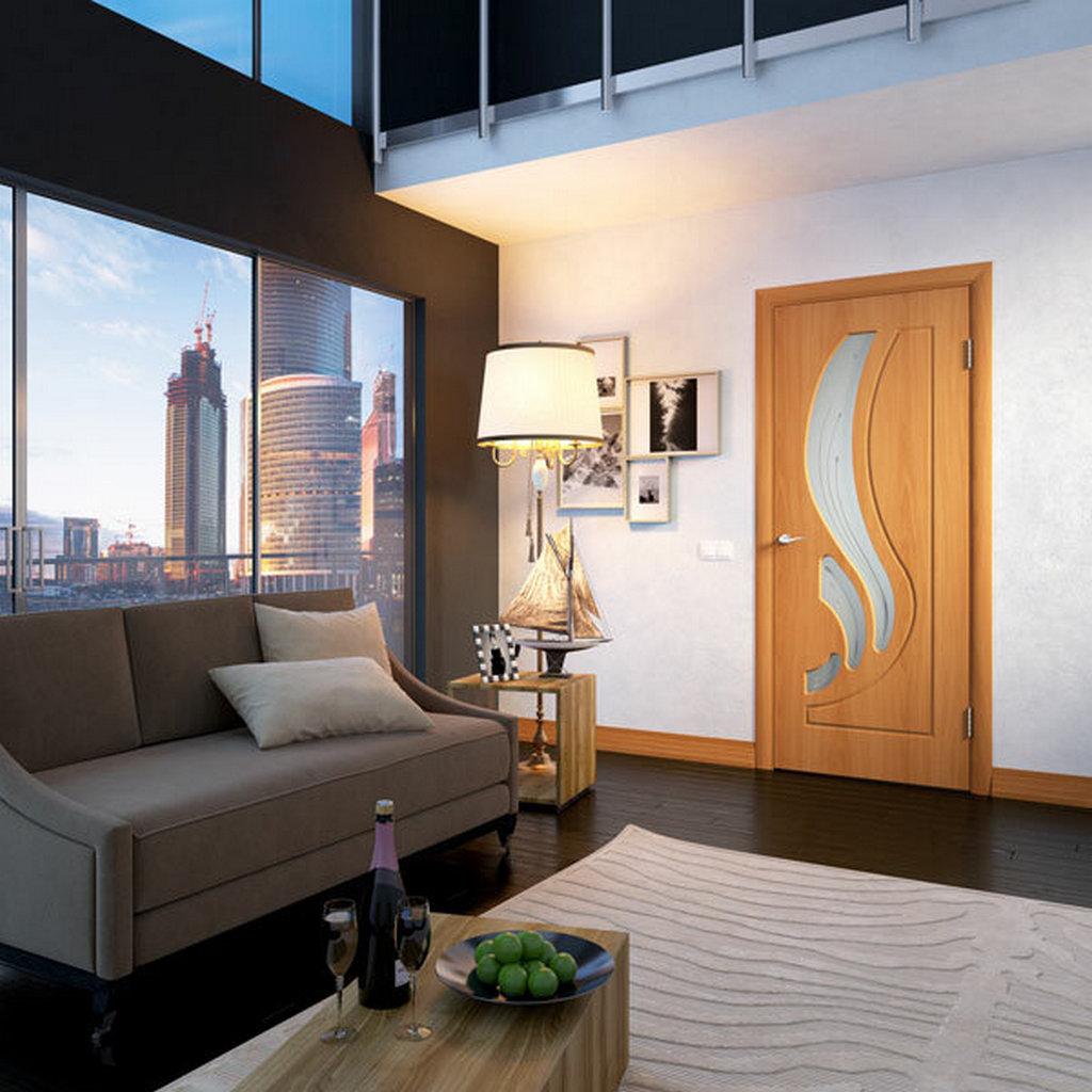 Дверь облицованная ПВХ в интерьере большой комнаты. Цвет миланский орех