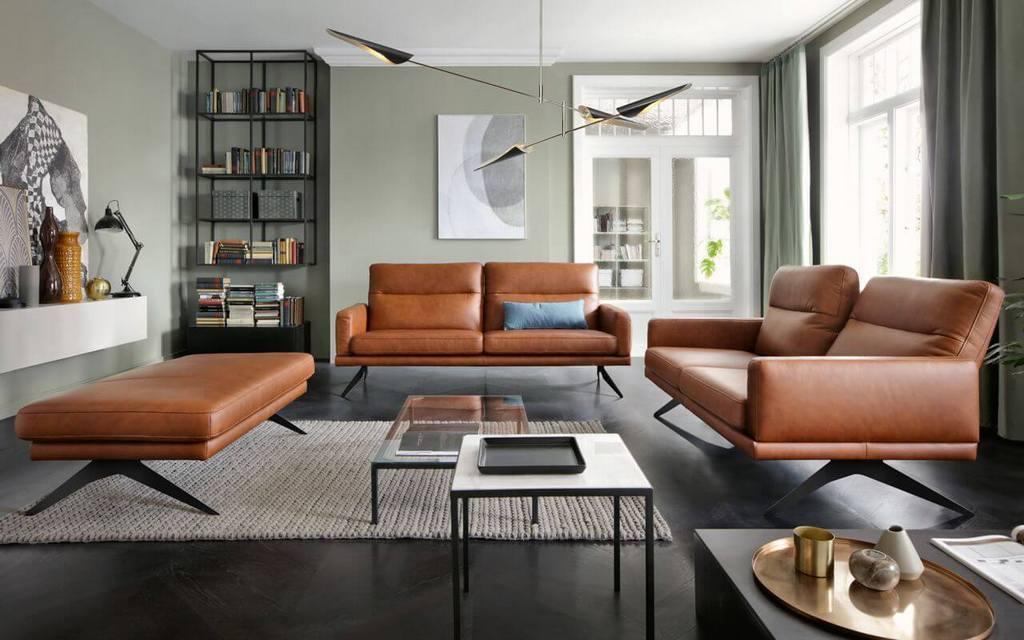 Как разместить кожаный диван в интерьере